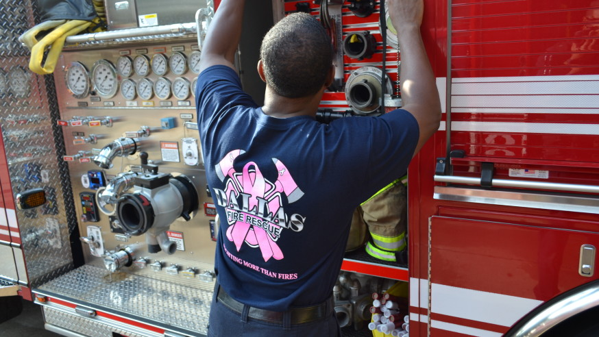 Firefighters don pink shirts in October for breast cancer awareness