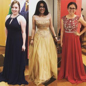 Three girls in prom dresses